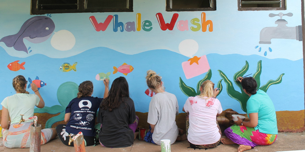 volunteers brightening up walls in Fiji