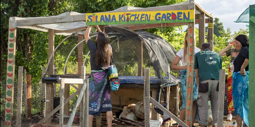 Volunteers assisting community members to set up a food garden in Dawasamu.