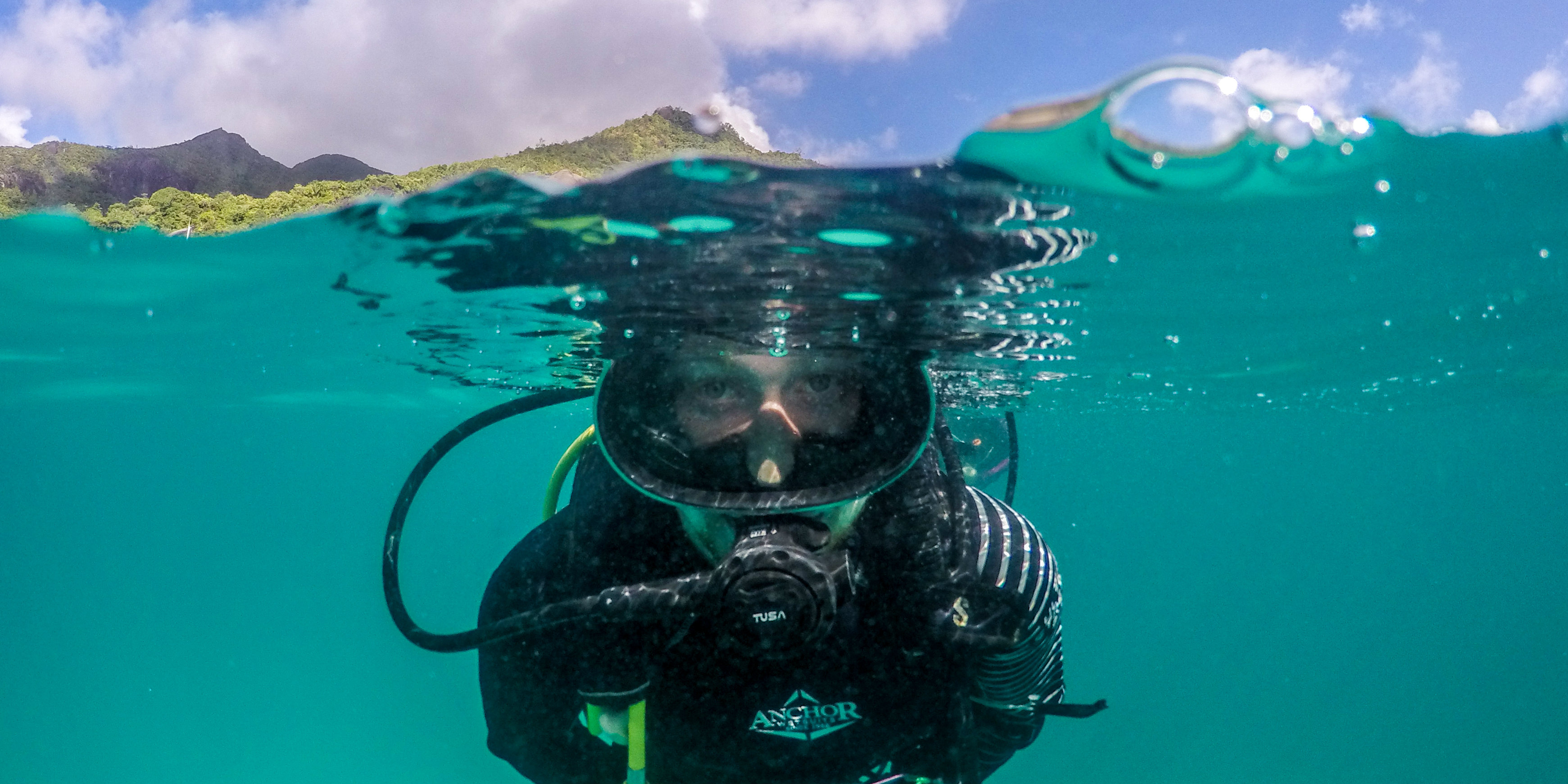 Becoming a PADI certified diver ensures you explore sensitive marine environments responsibly and safely. Pictured: A GVI participant practices diving skills on a marine conservation base.