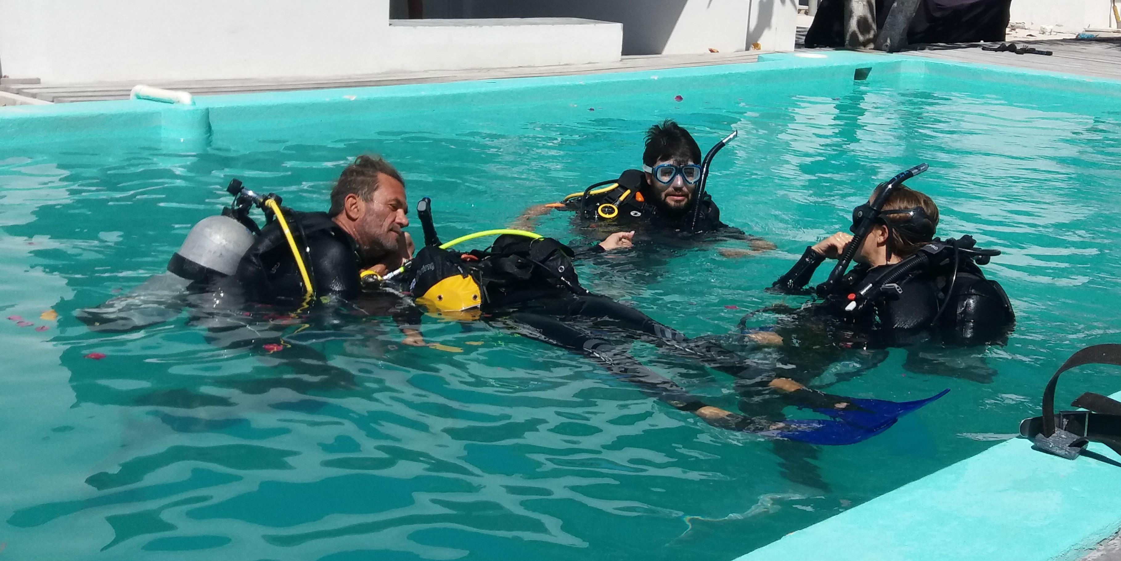 PADI pros train budding divers in a pool.