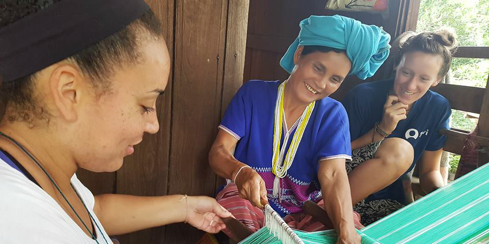 Trained GVI staff provide essential insight into the nuances of the culture of your host country. Pictured: paying volunteers and staff members learn traditional weaving from a women in Chiang Mai.