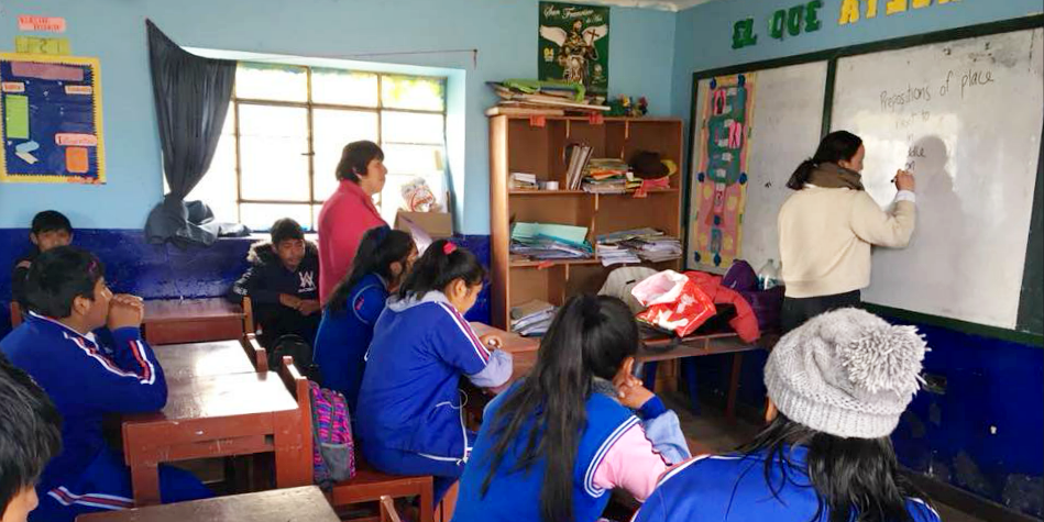 Gap year volunteers lead an English lesson with children in Cusco, Peru.