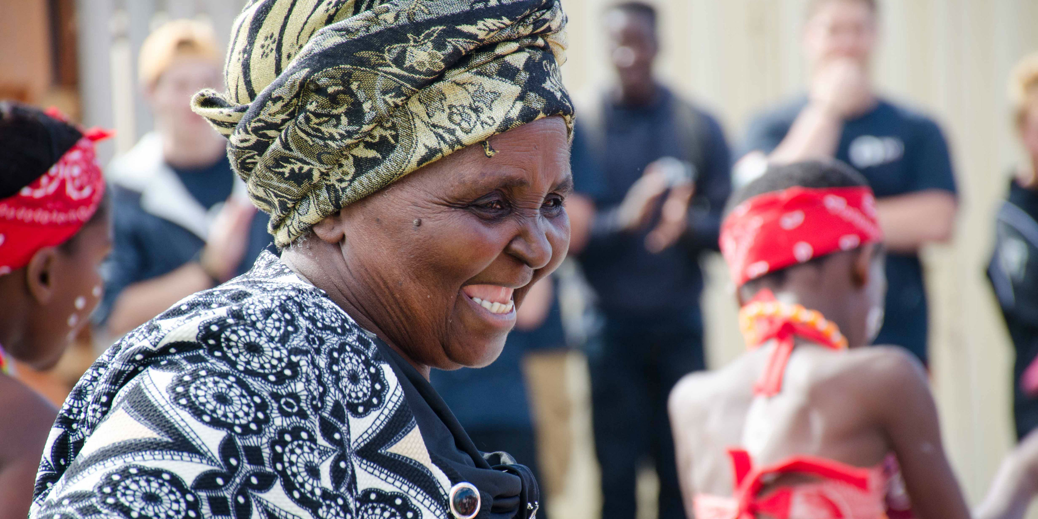 A women celebrates in Cape Town, South Africa. As a volunteer in South Africa, you will work with local women on activities for women's empowerment.