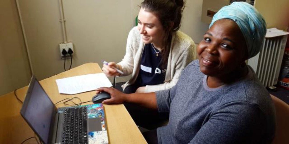 A woman participates in a computer literacy workshop as part of a GVI women's empowerment program.