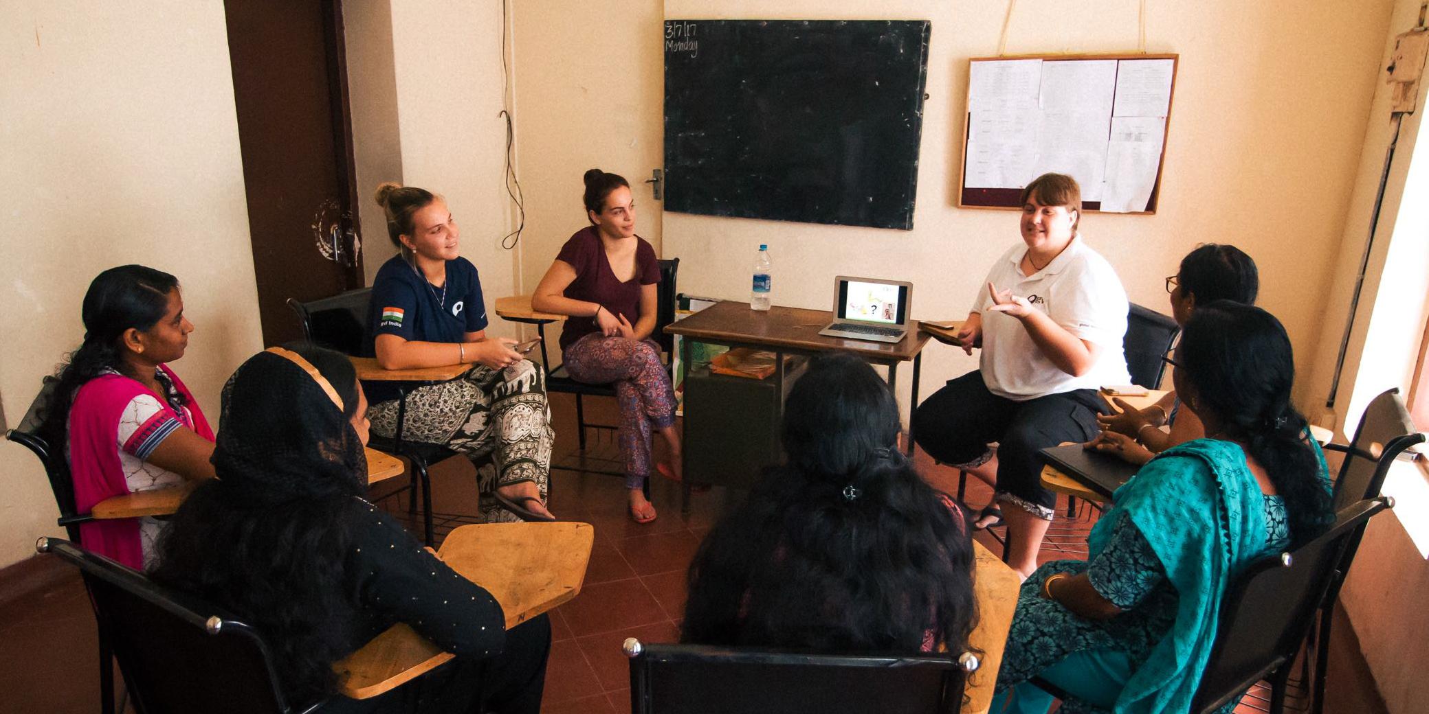 A GVI staff member leads a women's empowerment workshop in Kerala, India.