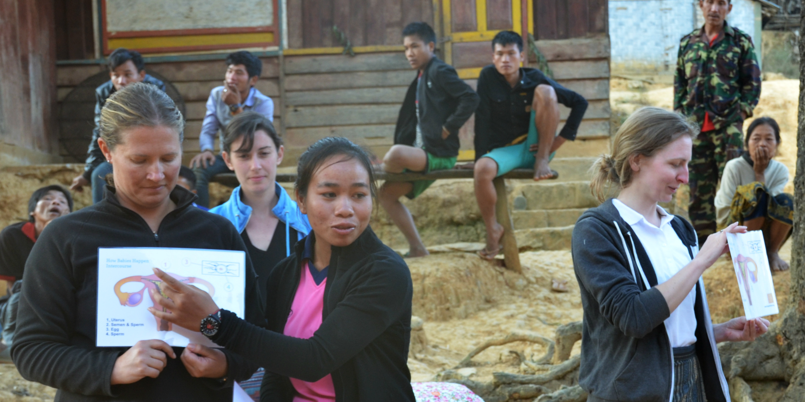 A Laos woman leads a menstrual health awareness workshop in a rural village, as part of community development in the region.