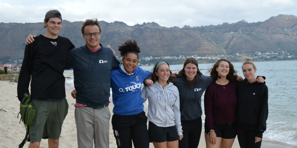 A group of GVI volunteers on a beach