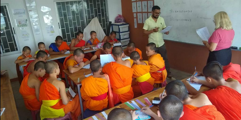 Volunteers teaching English to novice monks in Laos.