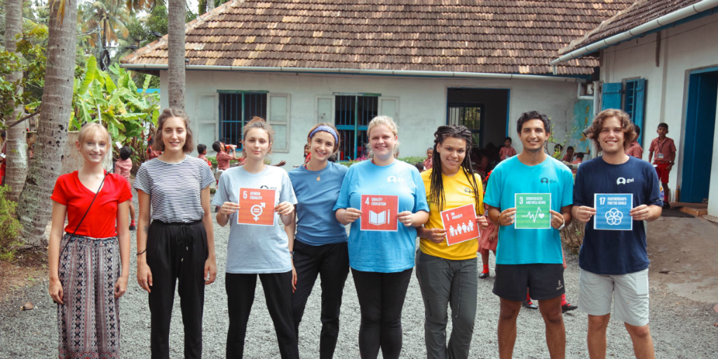 Volunteers holding up some of the UN SDGs in kerala