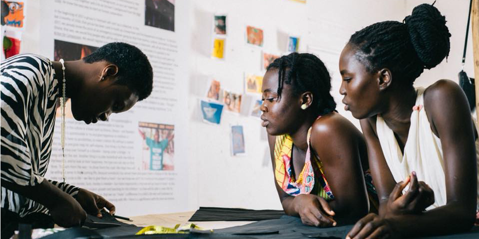 Ghanaian women work on textiles as part of a GVI skills development program. Getting involved in programs like these is one of our top gap year ideas.