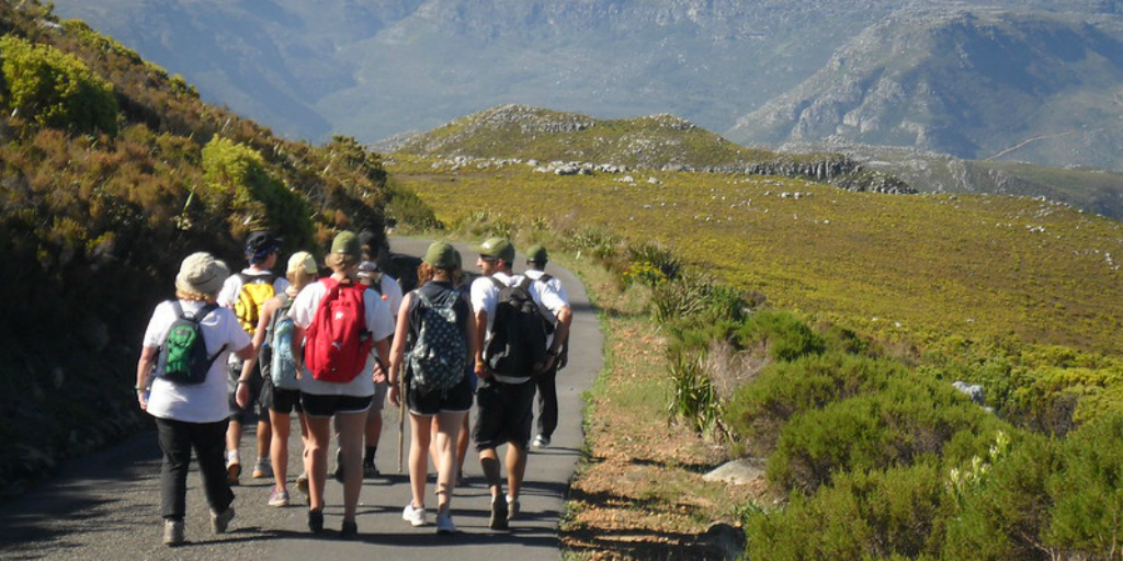 Participants enjoy a hike while on a gap year from college.