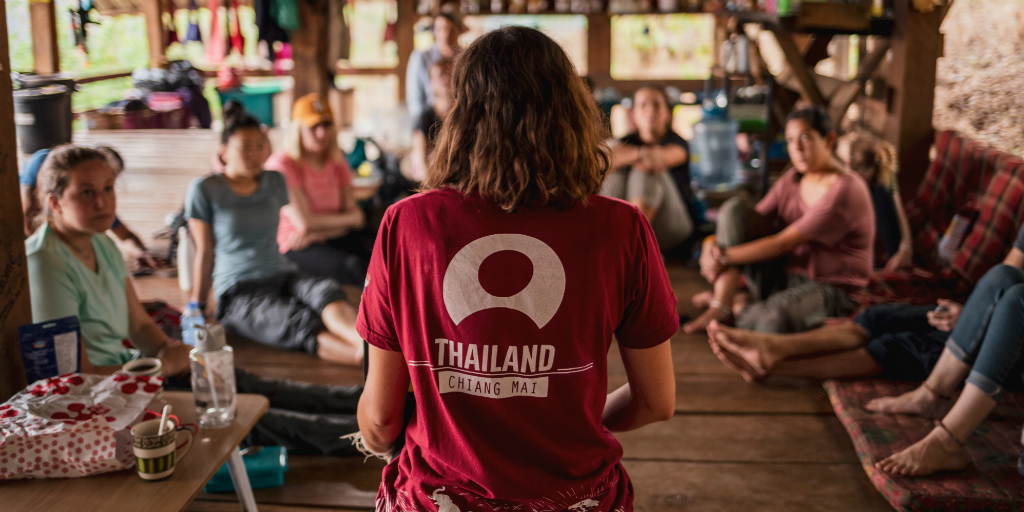 volunteers sharing stories about their day volunteering in Thailand