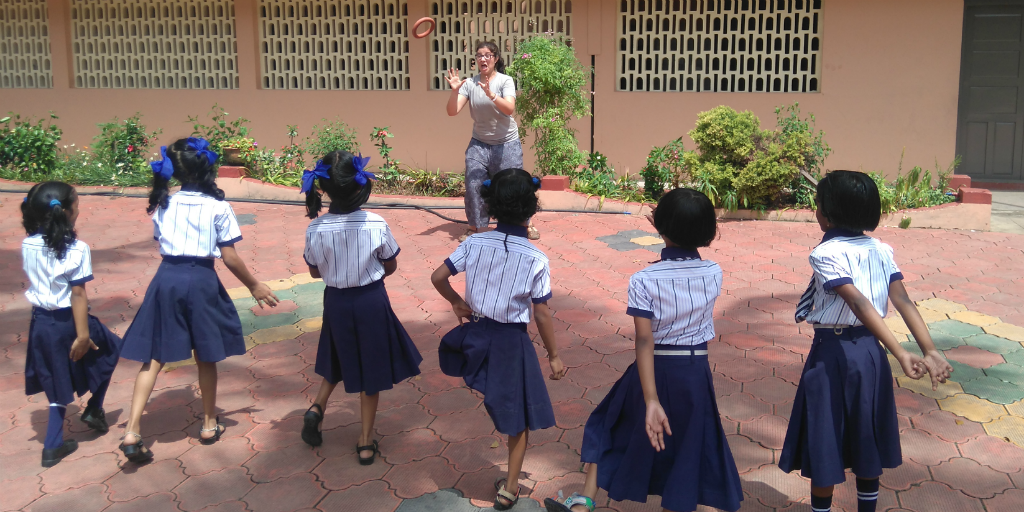 Volunteer with children on one of our India volunteer trips.