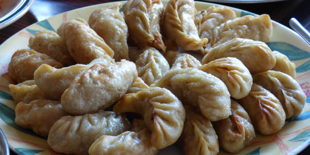 Taste a local dish in Pokhara when you volunteer in Nepal.
